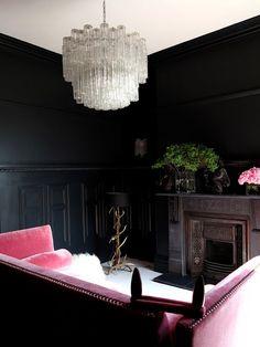Black walls, pink sofa