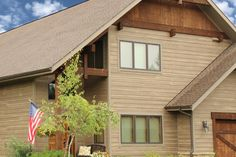 RusticSeries Lap Siding on LP Smartside. Color is River Rock. Beautiful single family home architecture home design.