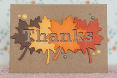 handmade Thanksgiving card ... four die cut maple leaves form a panel ... THANKS die cut out for negative spance ... kraft card with some enamel dots ... luv the originality ...