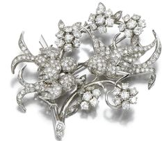 A stylized bird and flower brooch, 1960's.