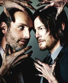 """Andrew Lincoln & Norman Reedus<- I love how you can tell Norman is trying so hard not to smile and Andy's like """"dude come on"""""""