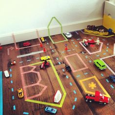 Imaginative play with washi tape and cars.