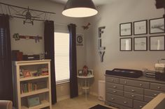 """Letters on the wall and grey paint. Would do with white and yellow or red """"parachute"""" curtains and dark-wash or white wash furniture so not everything is grey. Vintage Airplane Nursery, Airplane Room, Vintage Airplanes, Nursery Themes, Nursery Ideas, Room Ideas, Baby Boy Rooms, Baby Boy Nurseries, Gray Dresser"""