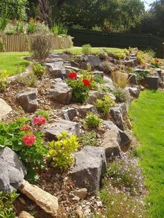 This free-form retaining wall posted by Garden Ideas Picture is so beautiful I can hardly stand it! I love how natural the boulders and pebbles look on the hill. And it's awesome that plants can be mixed into the retaining wall area!