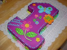 Cute for a butterfly or flower-themed first birthday paired with a separate flower mini-cake.