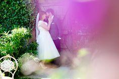 Ash Barton Estate Summer Wedding photo. Bride and groom shot thorugh green and purple foliage
