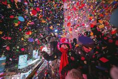 Revellers toss confetti over Times Square from a hotel after the clock struck midnight during New Ye... - Keith Bedford/Reuters