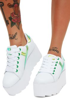 Y.R.U. Kermit Lala Strype Platform Sneakers will take ya to new heights. These dope white sneakers have iridescent green accents and thikk platform soles.