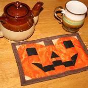 Jack O. Lantern mug rug - via @Craftsy