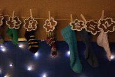 """Joulukalenteri omista villasukista"" (Alkuopettajat FB -sivustosta / Tanja Norrena) Clothes Hanger, Arts And Crafts, Xmas, Natal, Hanger, Closet Hangers, Gift Crafts, Christmas, Weihnachten"