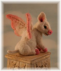 There is something about this that caught my eye. It looks like alot of time went into it. When Pigs Fly Piglet OOAK  Needle felted  Alpaca Artist Doll Bear by Stevi T.. $295.00, via Etsy.