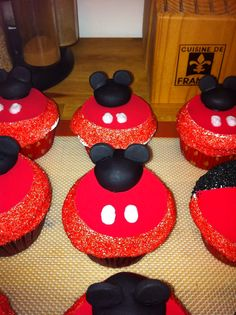 Mickey Mouse cupcakes ~ Fondant Mickey hat cupcake toppers.  Cupcakes by: Bella Baby Cakes