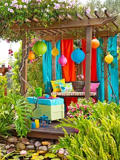 For bright, inexpensive color, turn to alternative items -- here, bedsheets -- for sun-blocking shades on a deck, patio, or pergola. Vintage finds are easily transformed into extra seating and storage for outdoor spaces: A found trunk becomes ottoman/coffee table/storage bench, thanks to bright paint, casters, and a cushion covered in a pretty patterned fabric.
