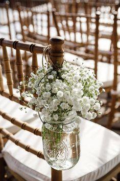 budget rustic wedding decorations gypsophila in a glass jar on the back of a chair amelia + dan #ChairDecorations #outdoordiywedding