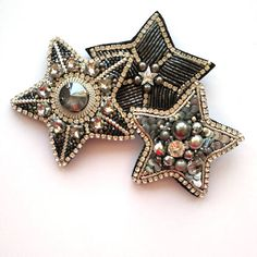 Attention! The item will be handmade by me to order. Production time - 10 days. Beautiful star, handmade embroidered brooch featuring fancy stones, Swarovski, french wire, Toho seed beads and black eco-leather backing. Brooch measures approximately 2.76 х 2.76 (7x7 cm). Looking for a more custom piece? Send me a message. Im always happy to work with my customers to customize a piece just for you! Follow me on Instagram: @orange_tree_bijou Thank you for visiting my shop. Hope to see you ...