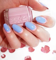 "Nail artist, @laurenslist, creates a wearable glitter ""cuticles"" look using a sparkling cornflower blue 'bikini so teeny', a sophisticated soft lavender pink 'french affair' and sparkles inspired by sugar crystals for Valentine's Day. (Want more holiday inspired nail art ideas? Visit http://www.essie.com/essie-looks.aspx)!"