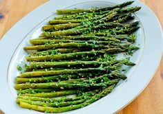 Kalyns Kitchen®: Recipe for Easy and Amazing Roasted Asparagus with Gremolata: Ingredients: 1 lb. fresh asparagus, thinner spears preferred for this recipe 1-2 T olive oil, for drizzling over asparagus salt and fresh-ground black pepper to taste  Gremolata Ingredients: 1 lemon, preferably organic 1/2 bunch fresh parsley 2-3 cloves fresh garlic Preheat oven to 400F Spray a large roasting pan or baking sheet with olive oil or non-stick spray.  Roast Asparagus around 15 min. Add gremolata…