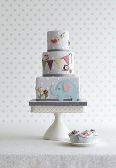 Muted Elephant Cake by Zoe Clark Cakes. Possible my favourite baby cake ever.  I love the angles, the relief of the motifs and the colour palette is sophisticated without loosing the charm of it 'babyness'.