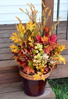 DIY Front porch curb appeal foliage: reuse pots from summer's flowers to take it into fall/autumn and then into winter - save yourself a few dollars on your decor. Materials were less than 20 bucks from Michaels...the foam block, ribbon, and bright fillers with reds, oranges, yellows, gourds, & berries