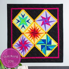 """Join us for our Milky Way Wall Hanging Quilt Along featuring paper-piecing. This colorful quilt was designed by Cheryl A. Adam. We asked Cheryl what was her inspiration for the design and why she selected paper piecing to create it. """"I love to be in the country, away from all the city lights, and gaze …"""
