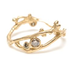 What a uniquely crafted ring! Three diamond bud ring (one secretly hidden!) engrained into a gold twiggy branch by Swallow.