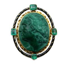 Antique malachite cameo in a gold frame, enamelled black in twist pattern, with with four emeralds in box settings . The cameo represents Mithreidates, king of Pontus, after the marble in the Capitoline Museum, Rome. Cameo circa1830, frame circa 1870