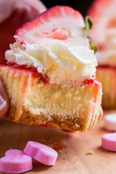 Mini strawberry cheesecakes are easy to make with simple ingredients. The texture in this strawberry cheesecake recipe is is creamy and smooth with a buttery crust. The fresh strawberry topping is irresistible. Valentine's Day Dessert!   natashaskitchen.com