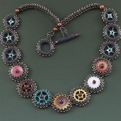 (This gives me an idea using buttons with a bead in the middle of each to hide the holes - ppr)