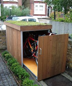 Outdoor Bike Shed - want this need this, but it must fit 5-7 adult bikes and room to grow for kid bikes.