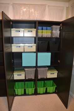 Toddler crafts/activity organization.   Ikea Besta.  Double shelf unit.  Bladis baskets.  Gles green boxes.  Glis little boxes.  Samla large and small boxes.  Drona bins.  Pingla  boxes.   http://www.ikea.com/us/en/catalog/products/70134044/
