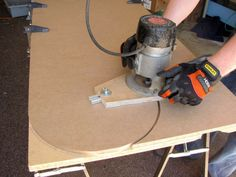 Router Trammel by Sean Michael Ragan -- Homemade router trammel based on Bill Hylton\'s design. Mounts in place of the factory baseplate. Used for cutting circles or boring holes on stock. The attachment consists of a base and an extendable arm. Base has an aluminum shoe. Cutting radius is set by adjusting the trammel arm. http://www.homemadetools.net/homemade-router-trammel