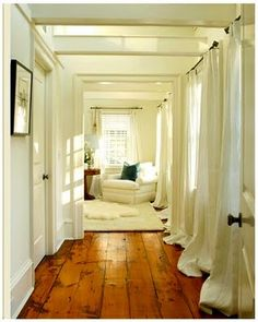 Gorgeous wood floor and those white curtains puddled on the floor....