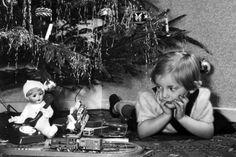 Vintage photo girl doll under Xmas tree