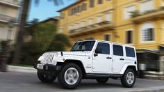 2014 Jeep® Wrangler Unlimited Sahara shown in Bright White with matching Hardtop.