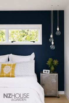Love the dark blue wall!