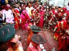 Lath mar Holi, Barsana The places that you must visit places during Holi includes Govardhan, Barsana and Nandgaon. Women of this Barsana village near Mathura in Uttar Pradesh usually beat up men from neighboring Nandgaon village with huge sticks, that what's known as Lathmar Holi celebrations.