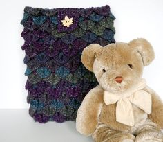 Purple and Blue Crochet Crocodile Stitch Cozy for iPad, also fits 9 inch Kindle, or 9 inch Nook. $30.00, via Etsy.