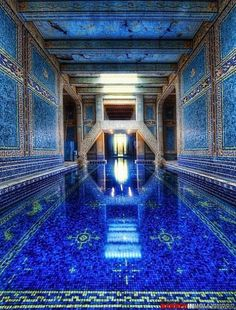 Beautiful blue mosaic swimming pool.