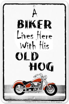A Biker Lives Here Tin Sign at AllPosters.com