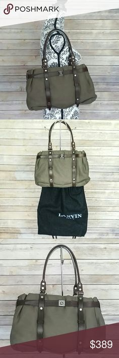 """100% Auth. Vintage LANVIN Paris Canvas Satchel Vintage and authentic LANVIN satchel in an olive greenish brown canvas with dark brown leather trim.  Full length interior pocket with zipper closure as well as an open pocket. It's in spectacular condition for being a vintage bag - only tiny scratches on the straps (see last pic). Gunmetal tone hardware hardly shows any scratches. Measurements: 9"""" X 15"""", top is 13"""", 4"""" deep, strap drop is 7"""". Comes with original dust bad. Made in Paris, France…"""