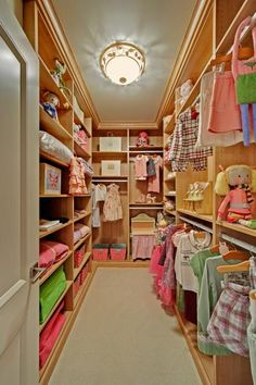 Kids' closets can be dreamy too. This adorable space was designed with California Closets' adjustable shelving, so it can grow with the child. When the child is young, everything is placed low and open for easy access. While the closet features feminine pastel clothes and toys, note that the shelving and flooring are neutral, so any age, taste or gender can be accommodated. The closet was featured in the 2009 Somerset Collection Showhome and built by Custom Homes by Derocher.