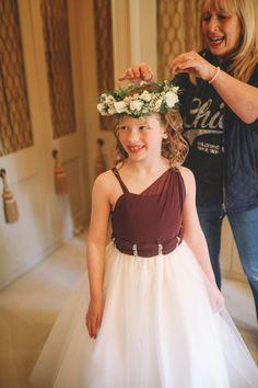 Cutie pie flower girls Maddie in our Amanda Wyatt dress getting her floral crown put in her hair! | Amanda Wyatt | Bridesmaid | Flowergirl