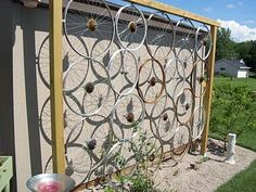 How's this for a idea for a wall or trellis in your garden? Grab a load of old wheels, pop them together in a frame and hey presto! You'll b...