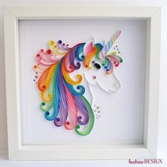 UNICORN QUILLING WALL ART   #THE DESIGN# This unicorn has been completely handmade from 120gsm 5mm quilling strips mounted on 160gsm white acid free card. The quilled piece is then placed inside a white rectangular box frame measuring W 23cm, H 23cm D 2cm (approx 9x9inches square)  To see more of my quilled artwork designs follow this link https://www.etsy.com/uk/shop/TheBeehiveHandmade?ref=hdr_shop_menu&search_query=wall+art   #CUSTOMISATION# This unicorn can be made bigger or smaller…