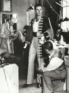 Errol Flynn at a costume fitting for Captain Blood (1935)