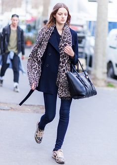 Leopard print scarf, navy peacoat, skinny jeans, and sneakers