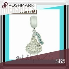 COMING SOON Hershey's Kiss Swarovski Charm Hersey's Kiss shaped charm is sure to brighten any Pandora or Kay's Charmed Memories bracelets. Rhodium-plated Sterling Silver with Authentic Swarovski Clear Crystals cut to sparkle brilliantly in any light. Beautiful charm to add to your collection!  Smoke free home. Open to reasonable offers unless marked as firm. Please no trades or low balls. Happy Poshing!! Swarovski Jewelry Bracelets