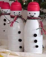 Snowmen made from coffee creamer bottles. Good recycle idea and great for candy gifts, home made coco or flavored creamer gift for holidays.