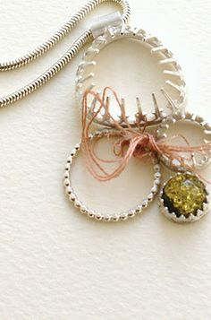 Nicola Reed - Missing Stones Pendant. Salvaged Bijoux for Made 2011 - Sterling Silver, Green Amber & Vintage Thread..