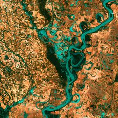Small blocky shapes of town, fields and pastures surround the graceful swirls and whorls of the Mississippi River.